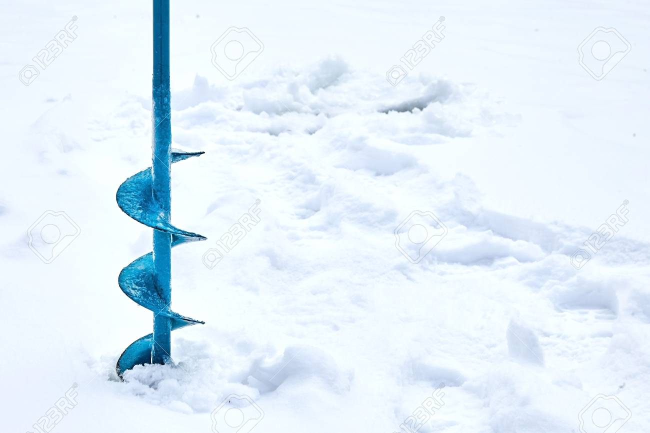 Hand operated ice auger used in ice fishing  Blue Metal Screw