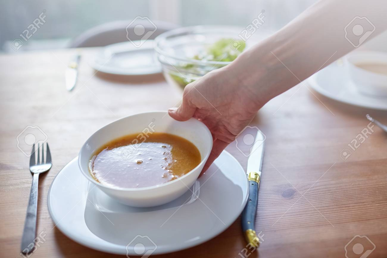 Female Hand With A White Bowl Of Vegetable Soup Serving Dishes Stock Photo Picture And Royalty Free Image Image 112124101