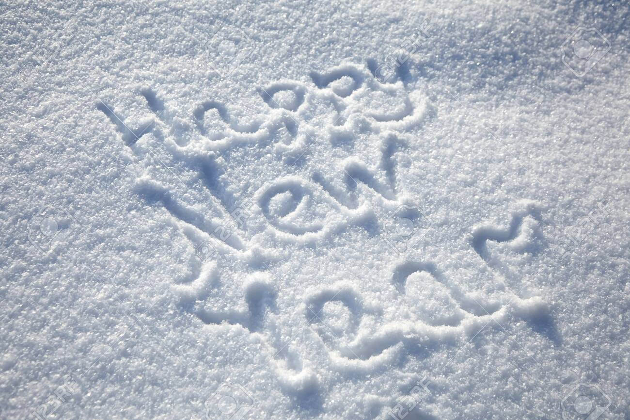 Inscription Happy New Year on snowy winter background, text on snow surface - 123900553