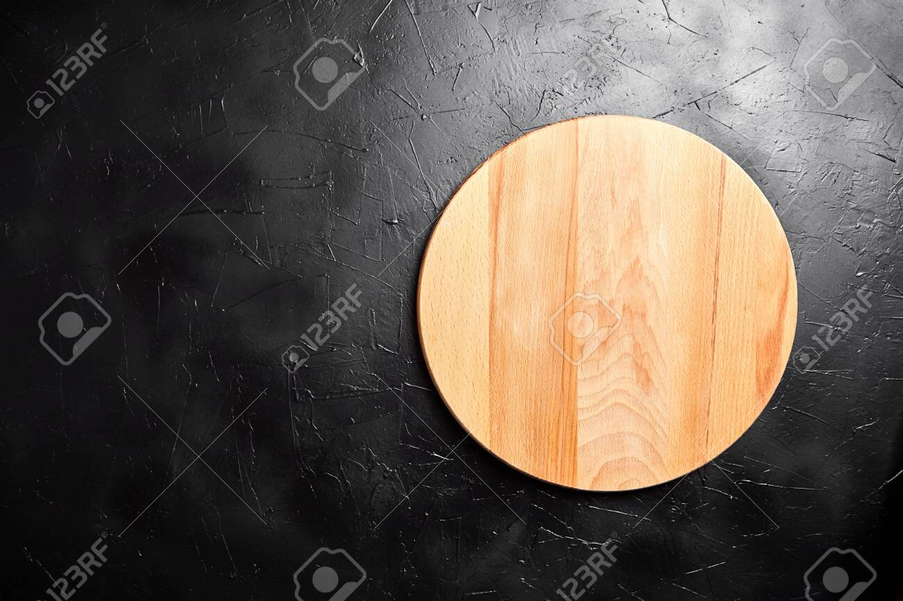 Cutting Board On Black Stone Table Empty Round Beech Wooden Stock Photo Picture And Royalty Free Image Image 144830201