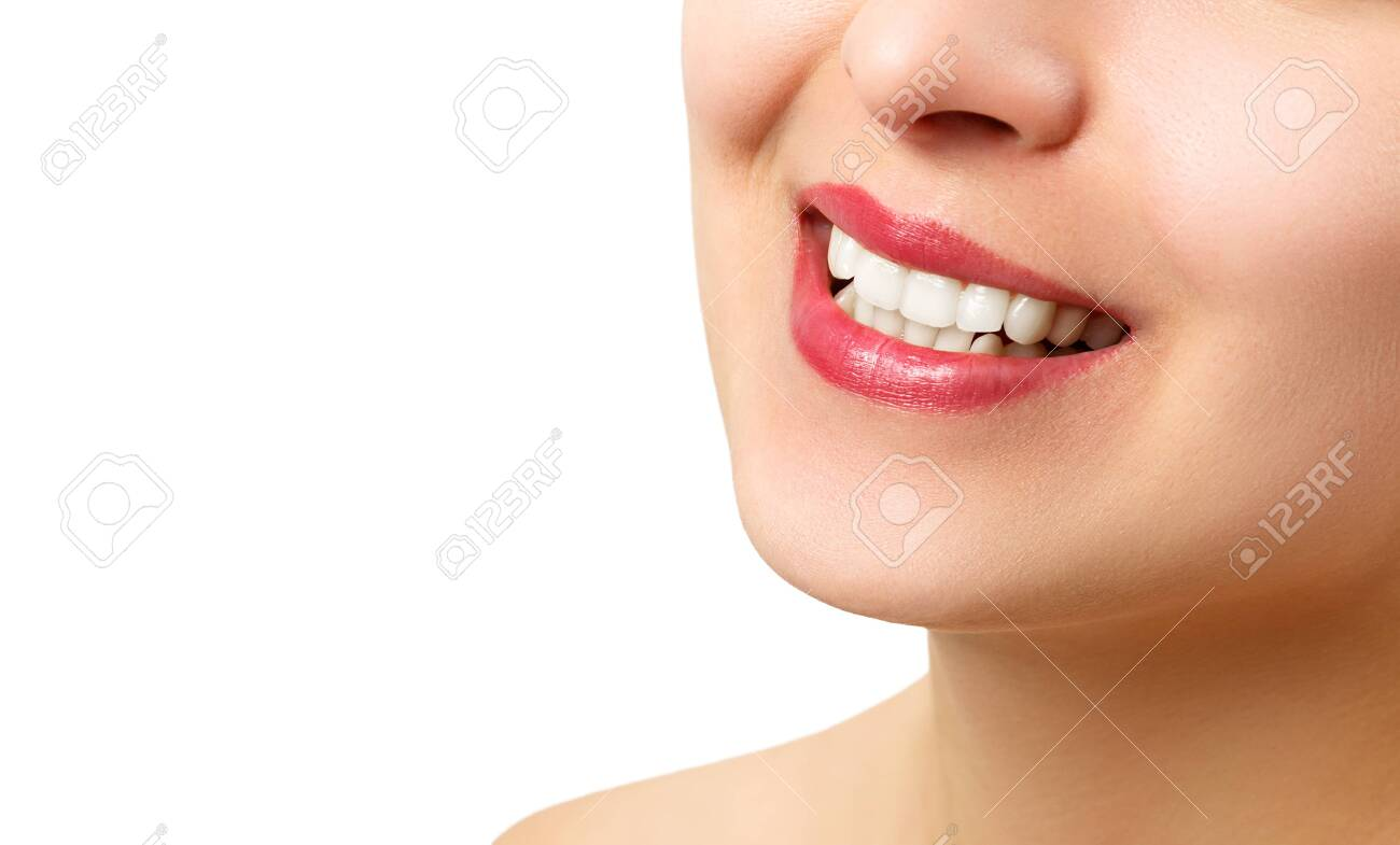 the smile of a young woman with perfect white teeth. close-up isolated on white background. place for copy space - 140563419