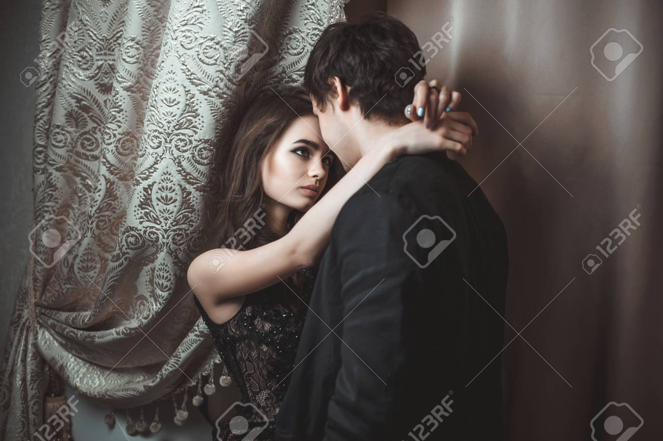 young beautiful pair of lovers hug and kiss stock photo, picture and