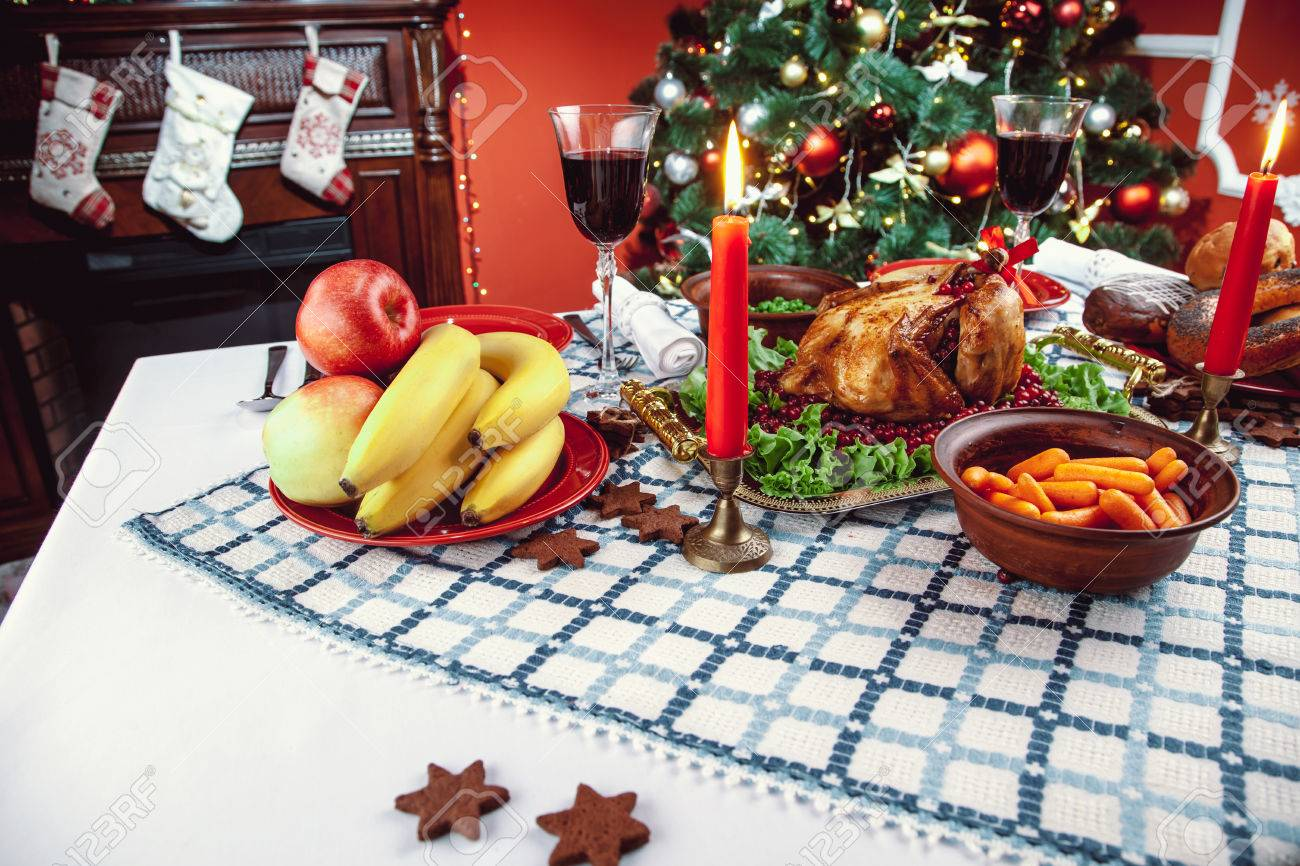 Christmas dinner by candlelight table setting. Thanksgiving table with baked turkey in a decorated & Christmas Dinner By Candlelight Table Setting. Thanksgiving.. Stock ...
