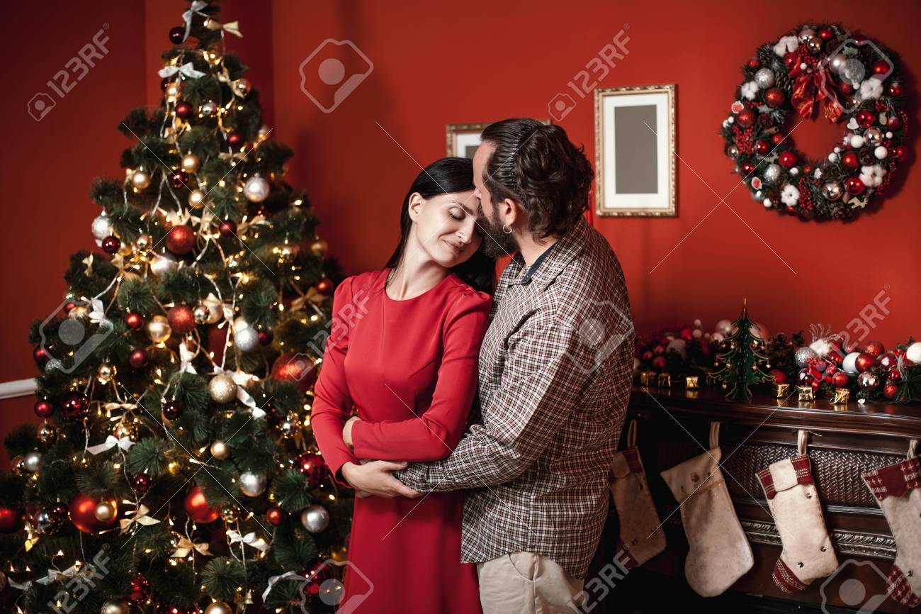 Holiday Living Christmas Tree.Family Portrait In Home Holiday Living Room Loving Young Couple