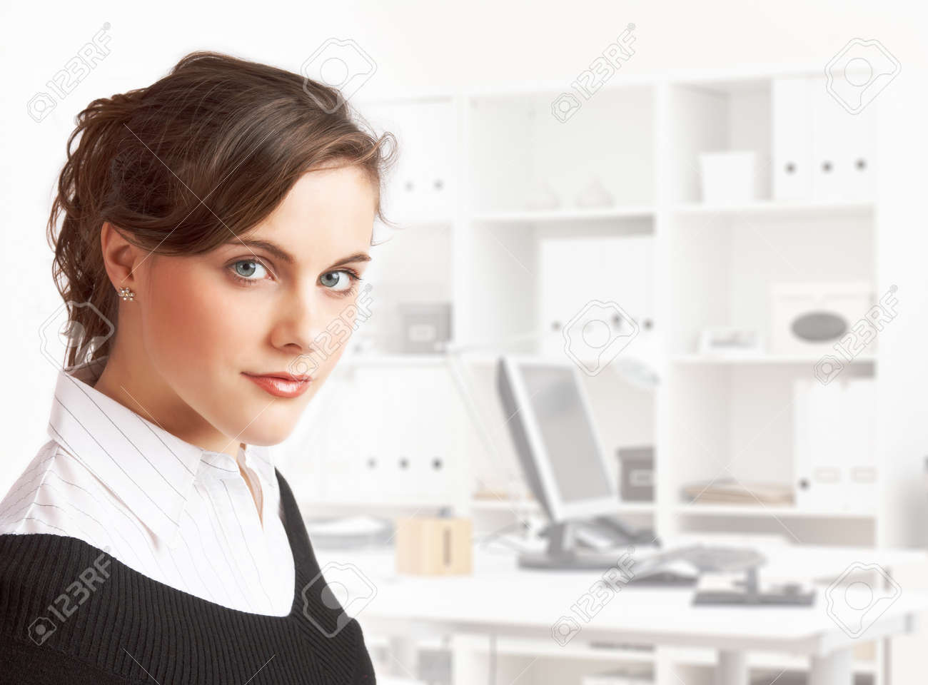 young pretty dark haired secretary standing in office Stock Photo - 7864601