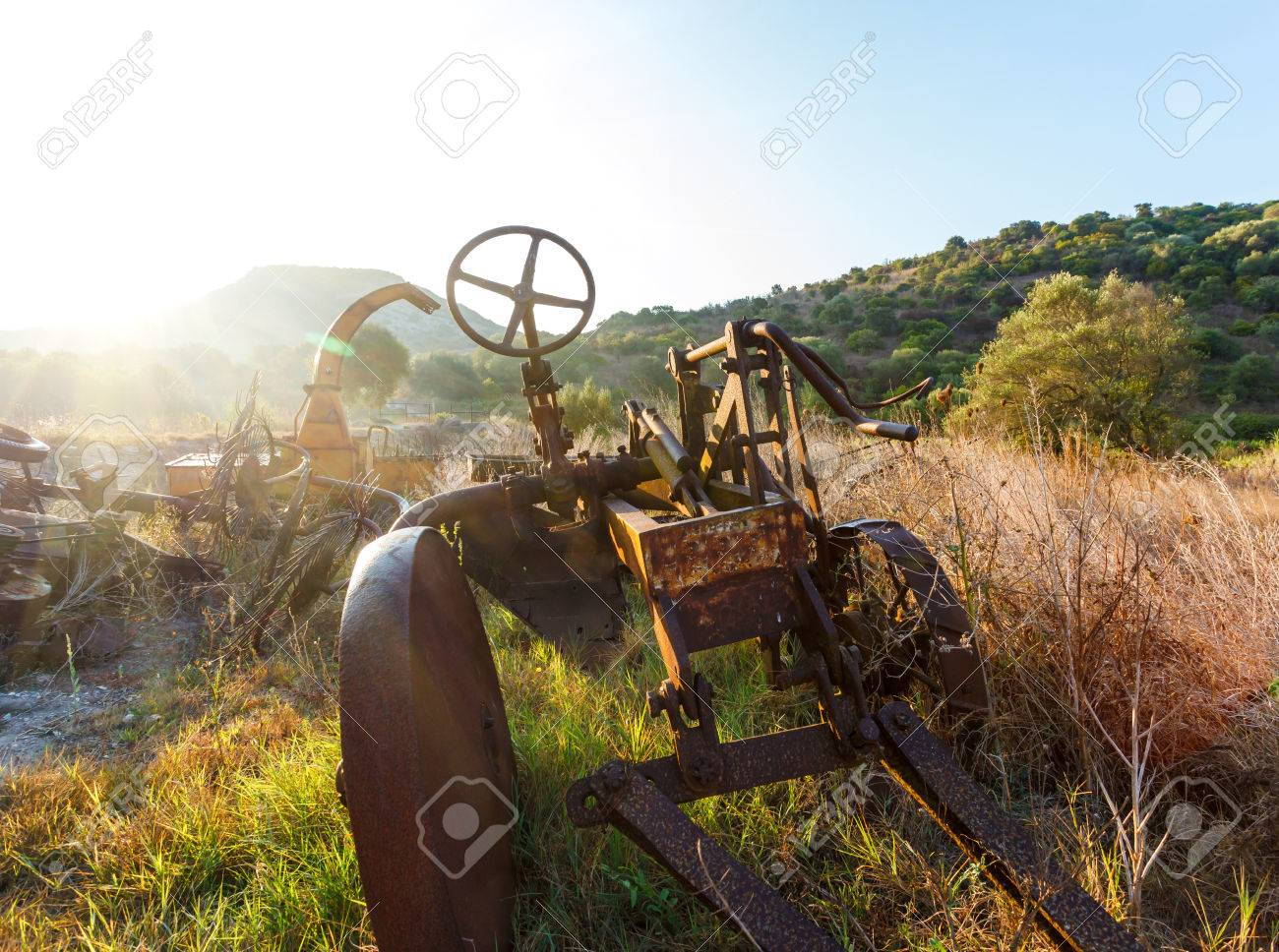 Antique Farm Equipment And Old Hay Rake At Sunrise Italy Stock