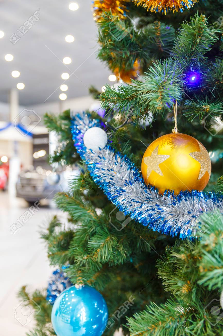 Colored Christmas Balls On Branch Christmas Tree In Showroom.. Stock ...