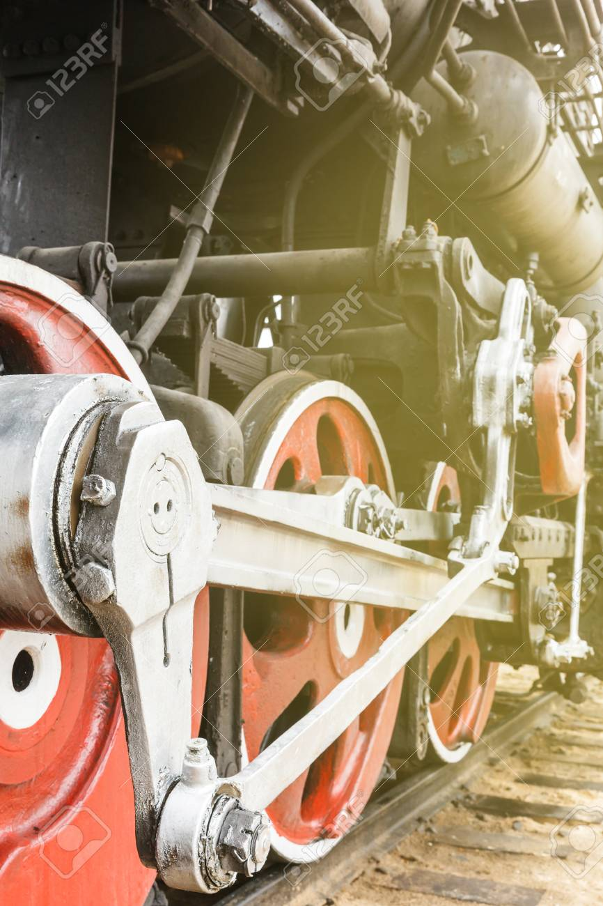 red wheel and detail of mechanism a vintage russian steam train