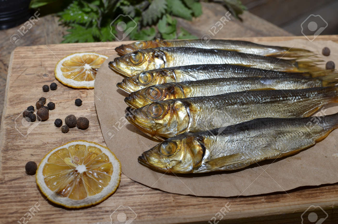 Delicious smoked salmon herring beautifully garnished on a rustic wooden table - 168508543