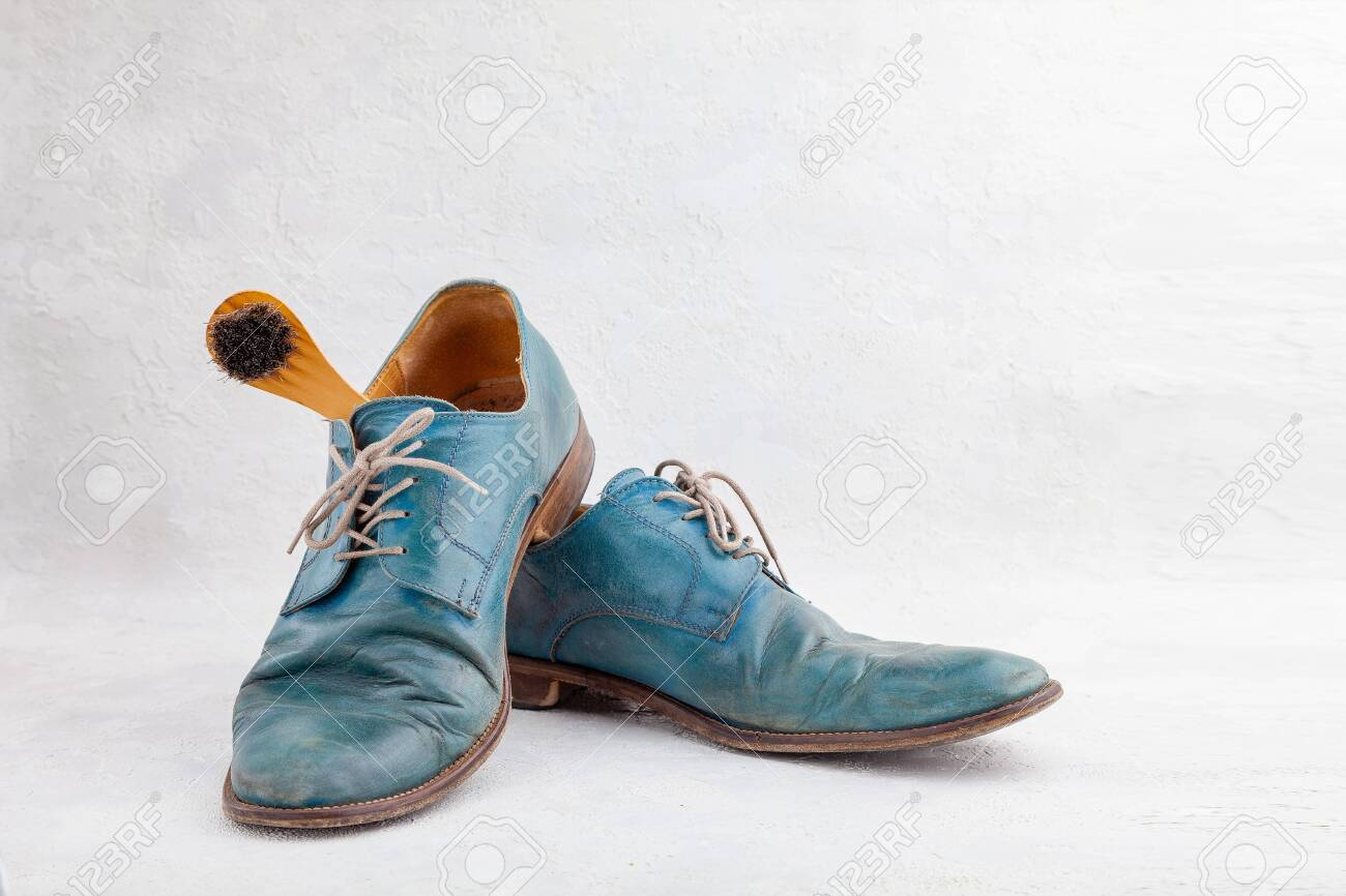 Pair of old leather blue boots with laces with shoe brush - 154432687