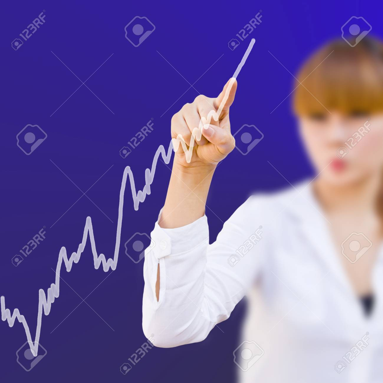 Analyzing stock market graph on a touch with businesswoman Stock Photo - 11738019