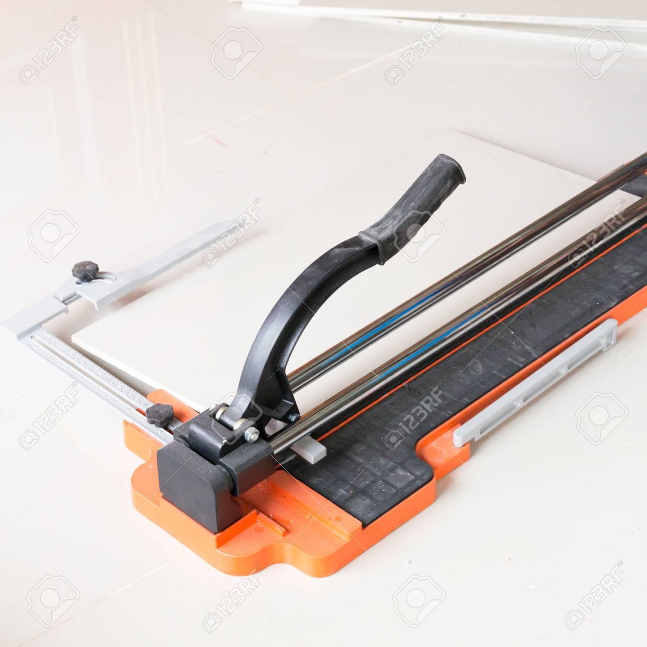 Ceramic tile cutting process using a manual cutter stock photo ceramic tile cutting process using a manual cutter stock photo 53181679 dailygadgetfo Gallery
