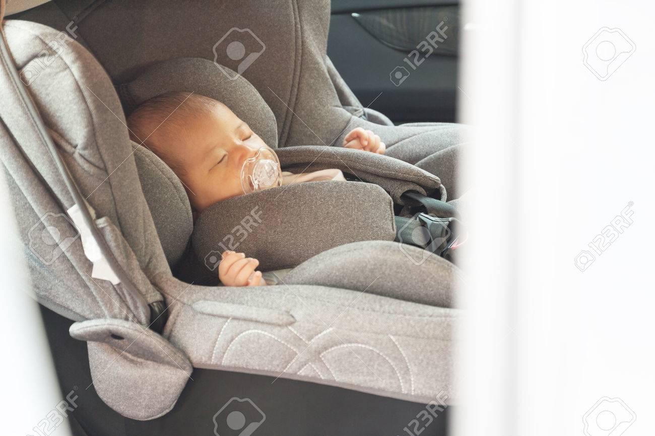 Asian Cute Newborn Baby Sleeping In Modern Car Seat. Child New ...