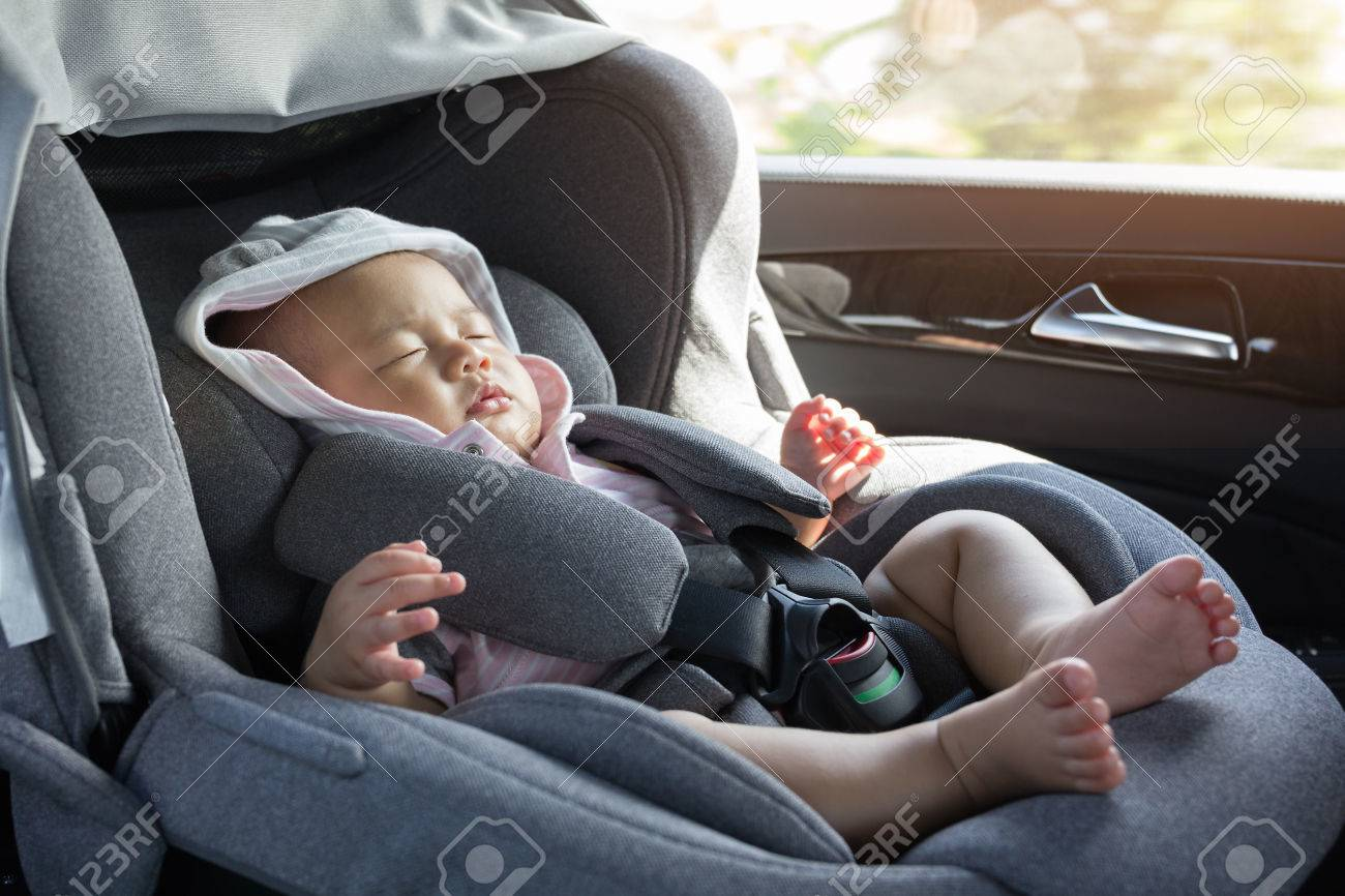 Close Up Asian Cute Newborn Baby Sleeping In Modern Car Seat Child New Born Traveling