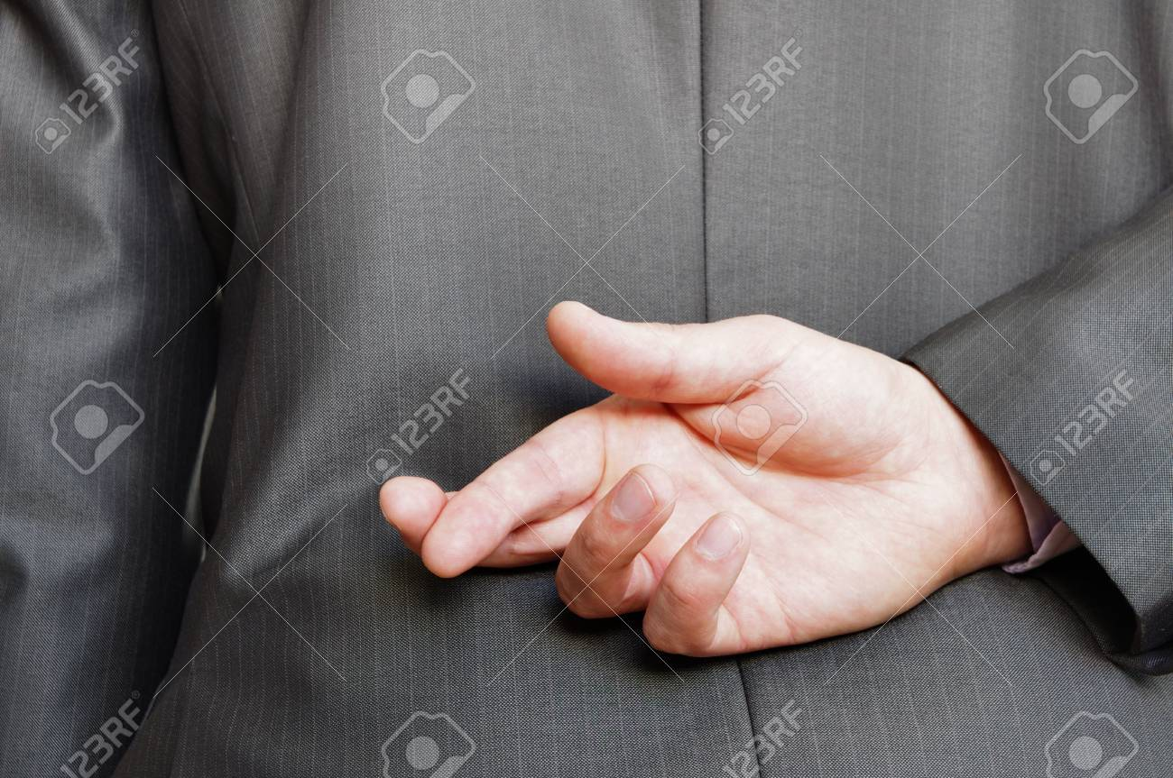fingers crossed behind a suited backside Stock Photo - 13748751