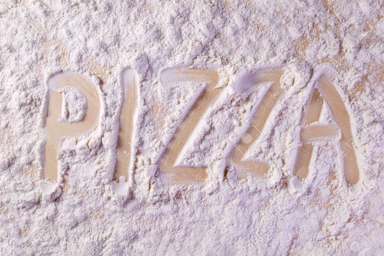 inscription on the kitchen board on the flour pizza - 170592466