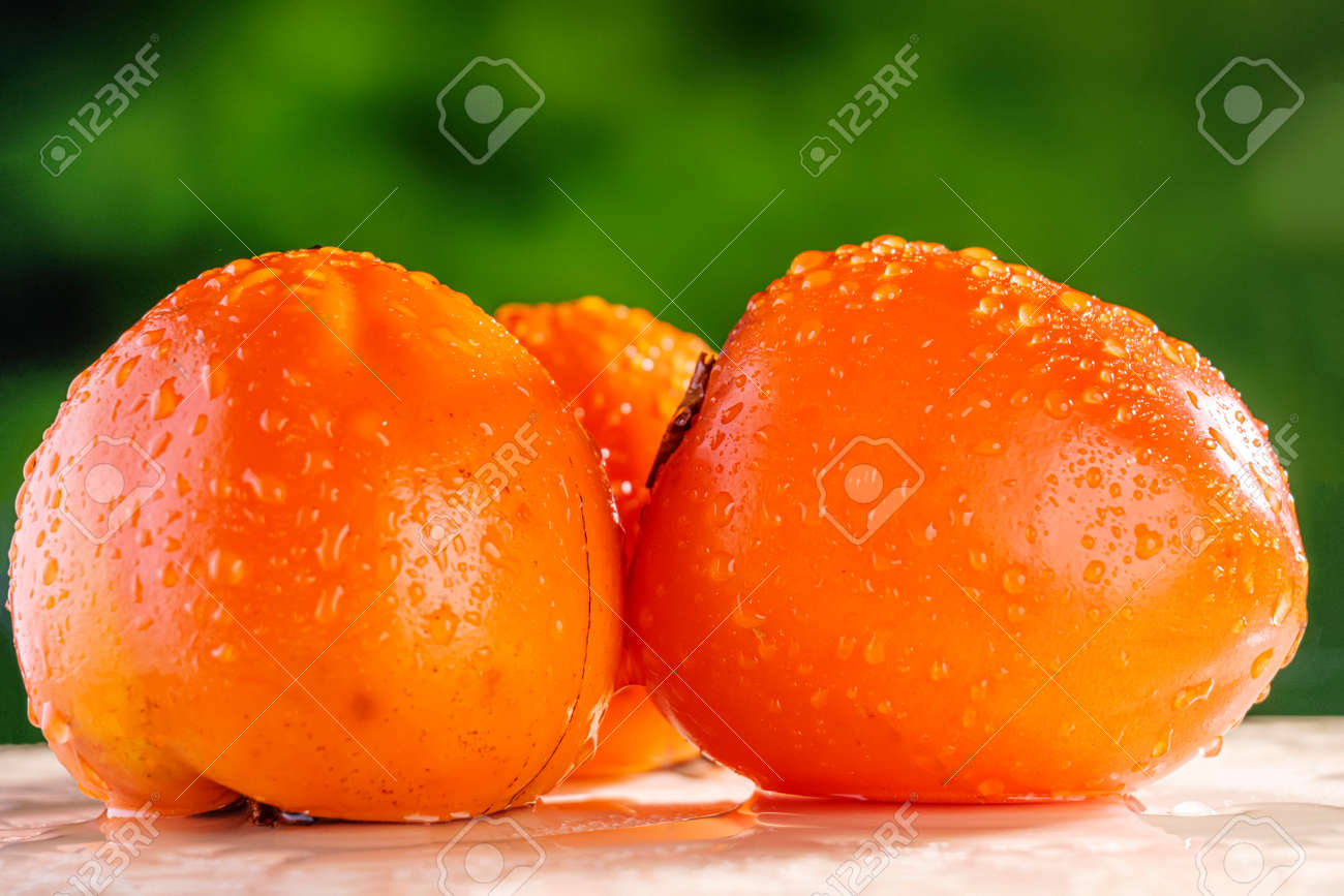 persimmon close-up with water drops - 170496765