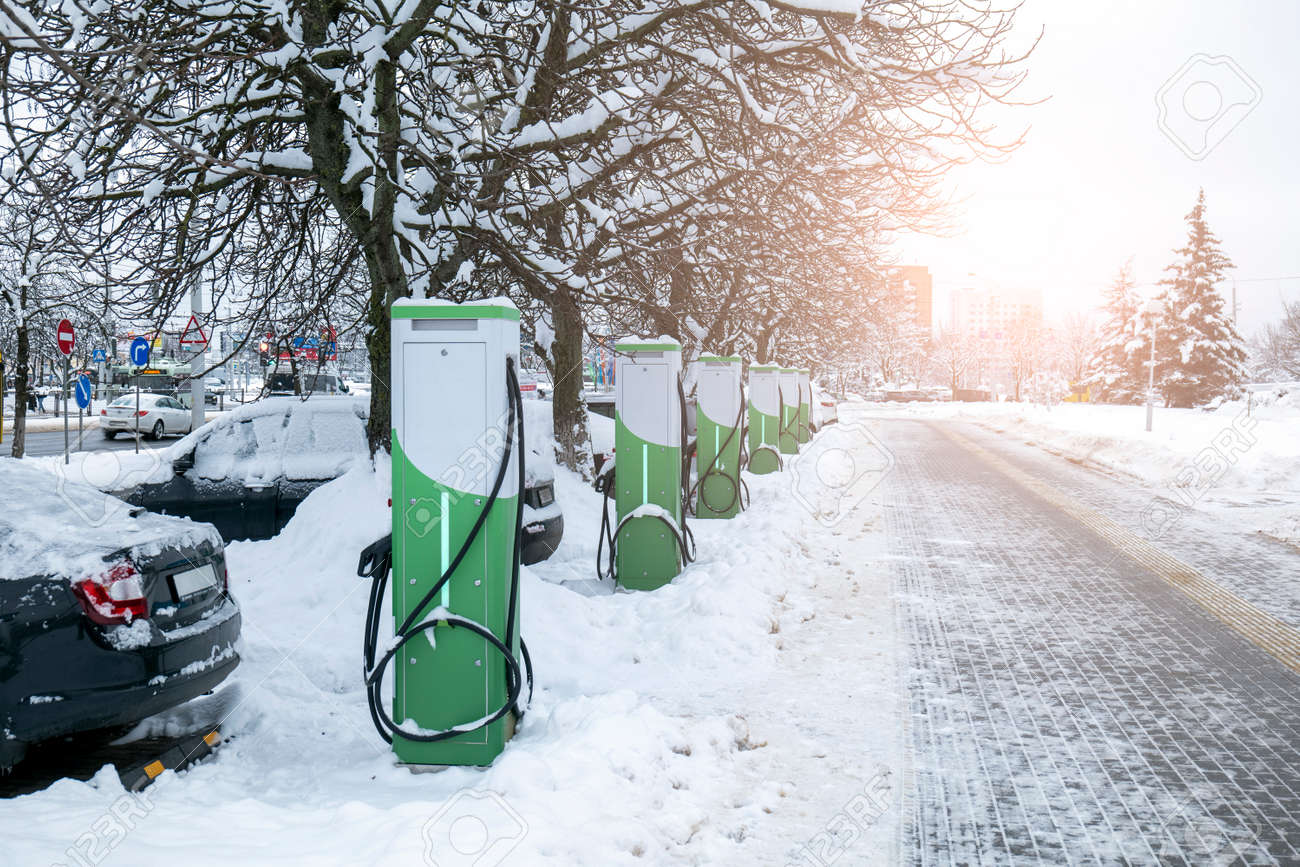 refueling for electric vehicles in winter. ecological chargers for cars with electricity - 170497588