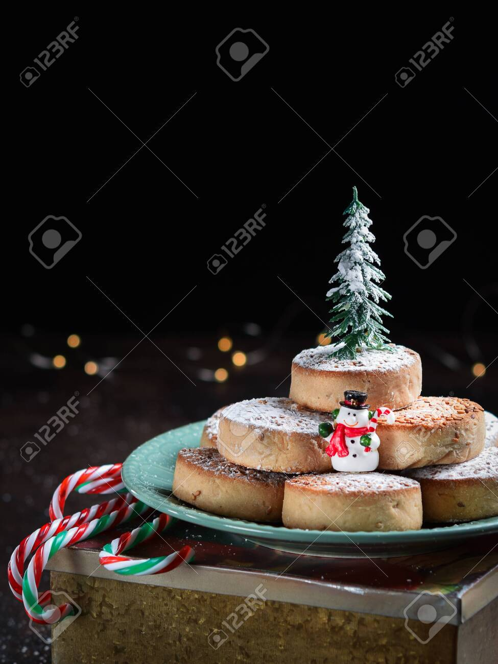 Typical Spansih Christmas Cookies Polvorones, mantecados, with almonds on dark wooden background with space for text. Christmas and New Year celebration concept. Holiday decoration. - 129540455