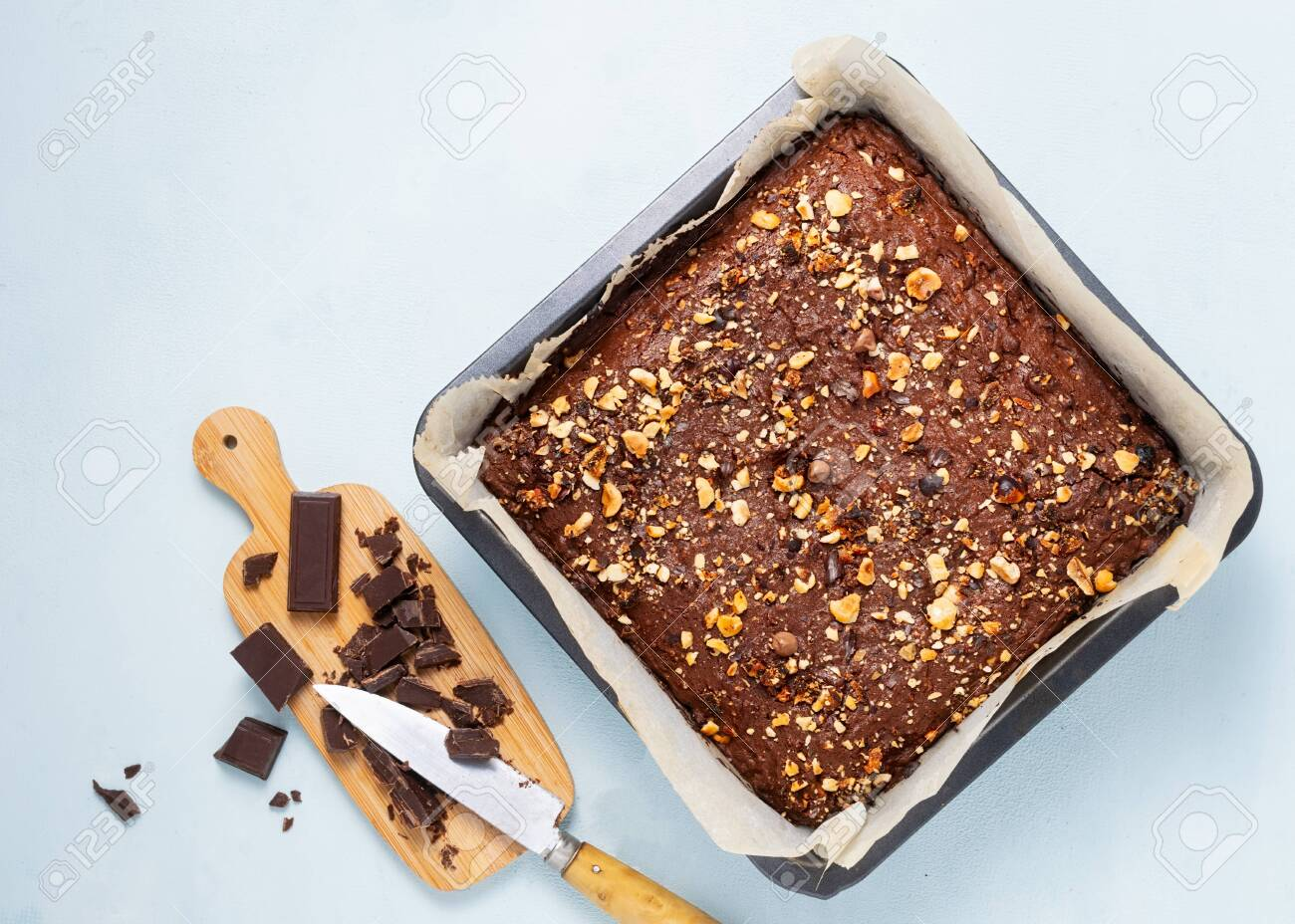 Chocolate brownie cake, dessert with nuts and fruits on dark background, directly above. Vegan, diet concept, suar free. Recipe step by step. - 131947146