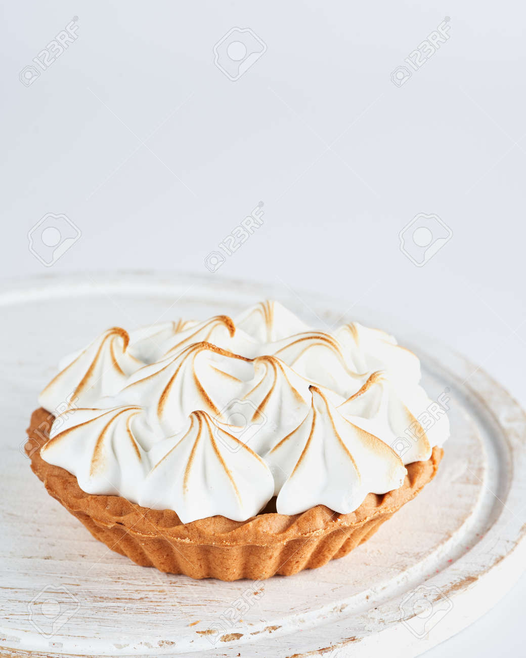 Lemon Curd and Meringue Mini Tart Pie on white background, selective focus, space for text. Bakery pastry dessert concept. - 169659240