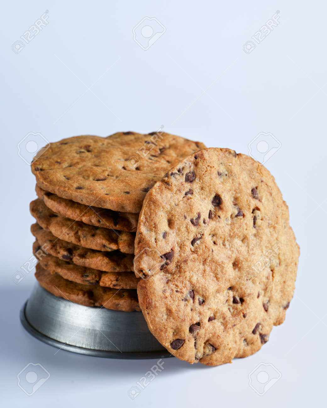 Big Soft and Crumbly Chocolate Chip Cookies. Close up view, selective focus, space for text. Sweets for sale in supermarket. Natural and proximity products. - 169659267