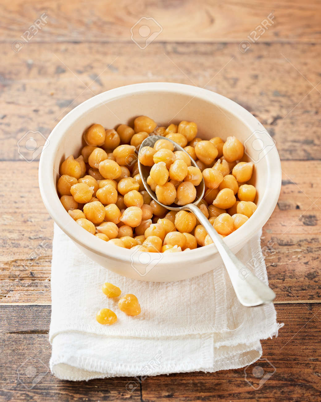 Cooked Chickpeas on a bowl wooden rustic background. copy Space, selective focus. Nutrition, Healthy, vegetarian food concept. - 173232643