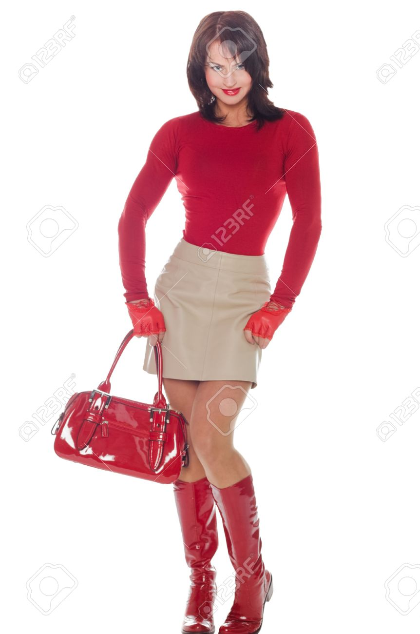 Young Woman Poses In A Short Leather Skirt And Red Lacquer Boots ...