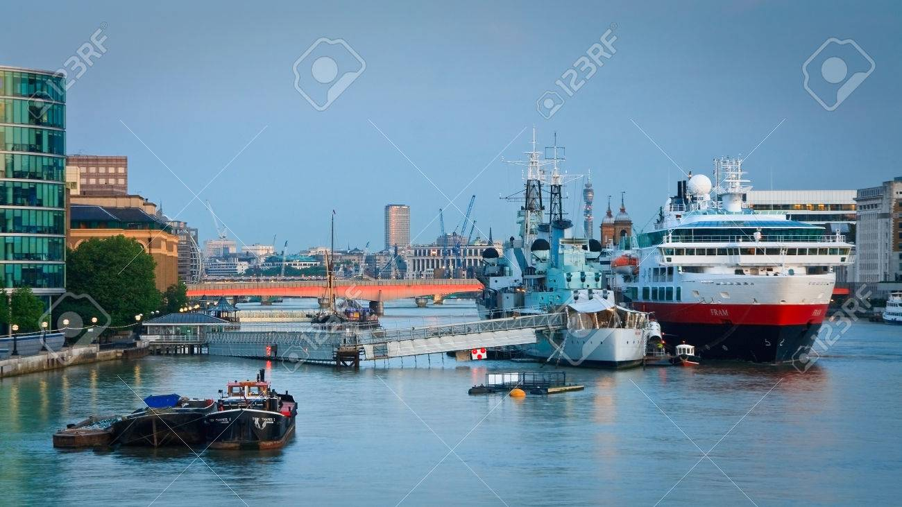 HMS Belfast And A Cruise Ship On River Thames In London Stock - Cruise ship in london