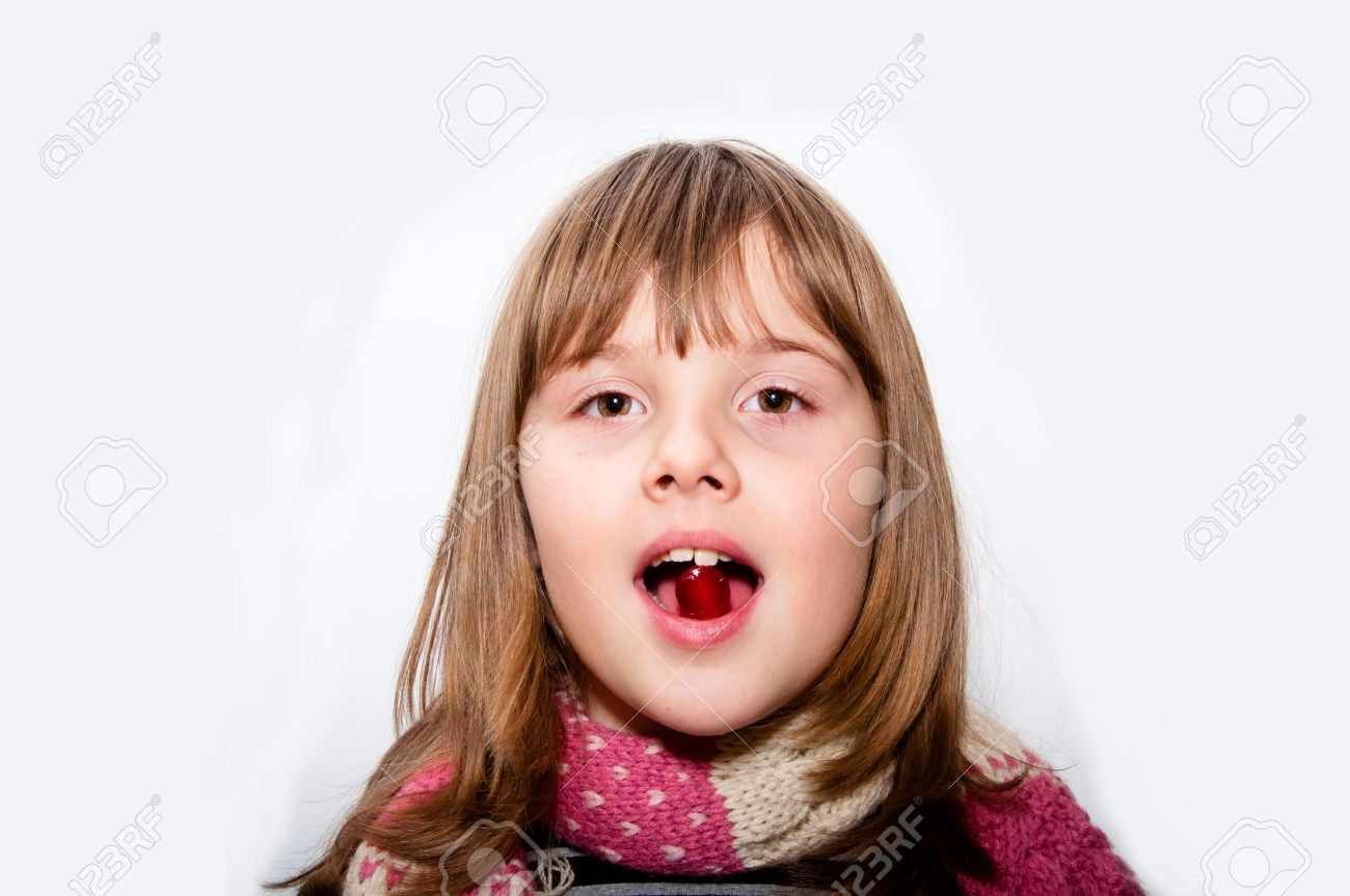 Ill Teen girl with scarf takes red pill in mouth isolated white portrait  Imagens - 34945434