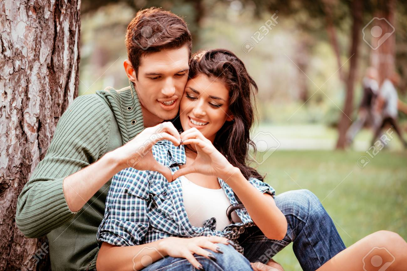 Beautiful Lovely Couple Enjoying In Park And With Their Hands