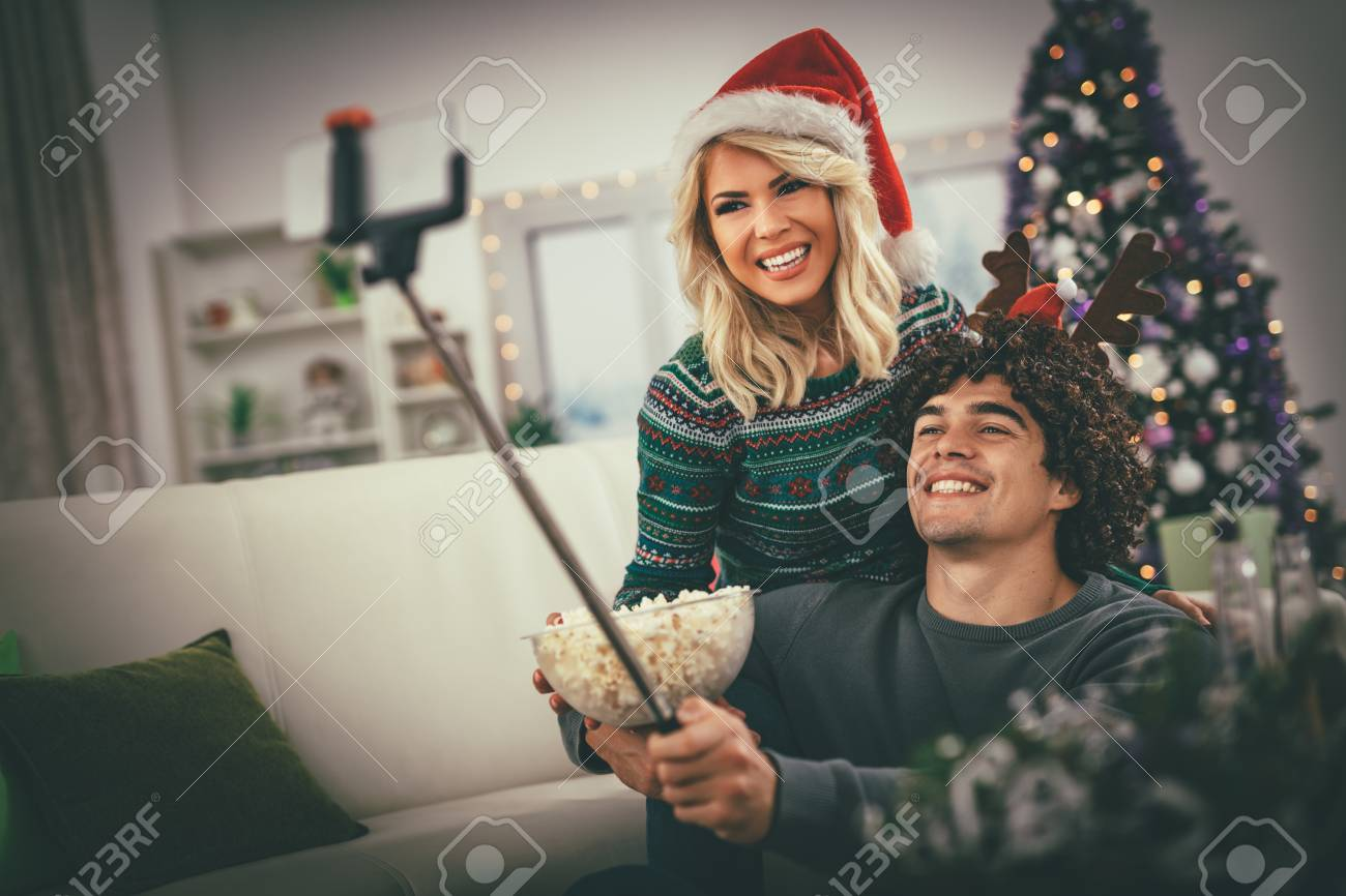 Loving Couple In Cozy Warm Sweaters On A Christmas New Year