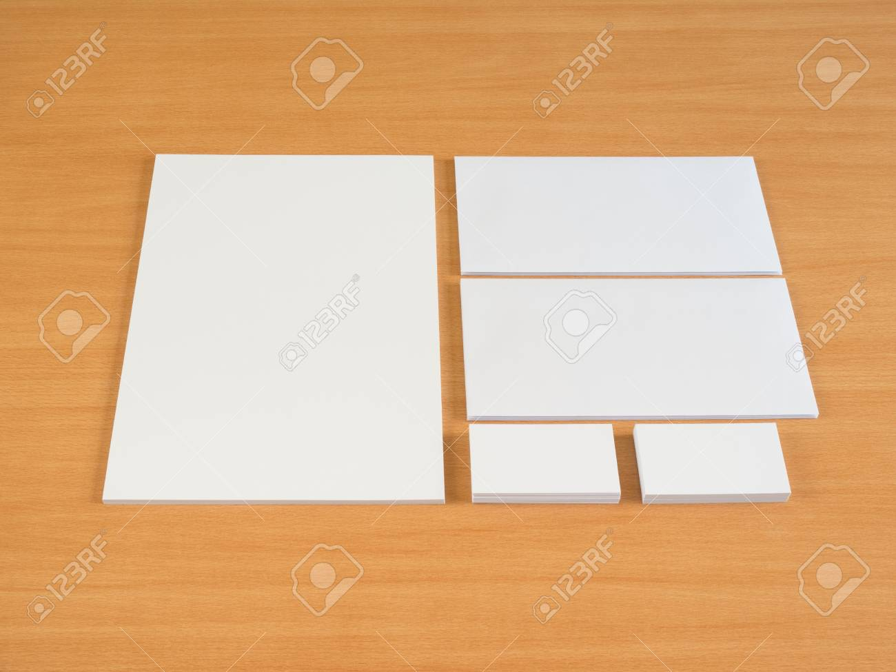 Stationary Set. Business Cards And Envelopes Isolated On Wooden ...
