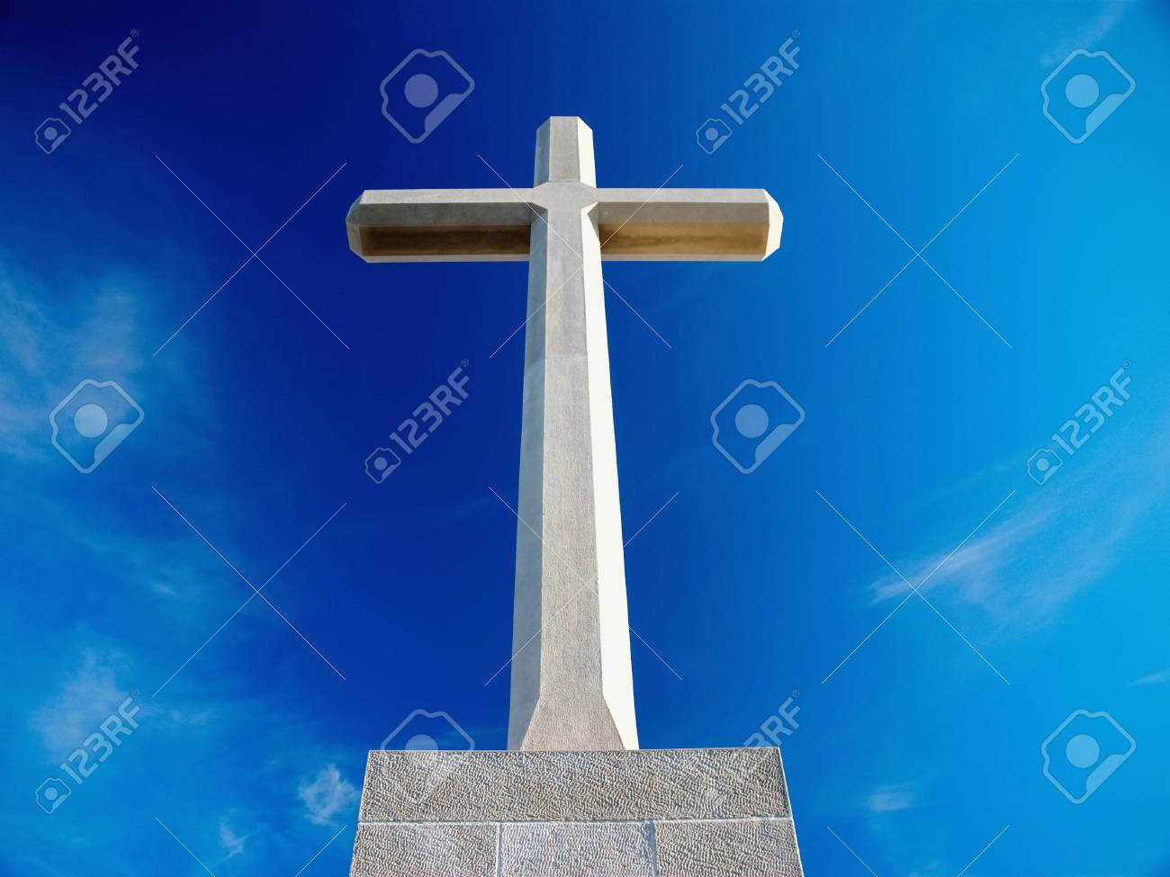 Big Christian cross over blue sky and clouds Stock Photo - 3477215