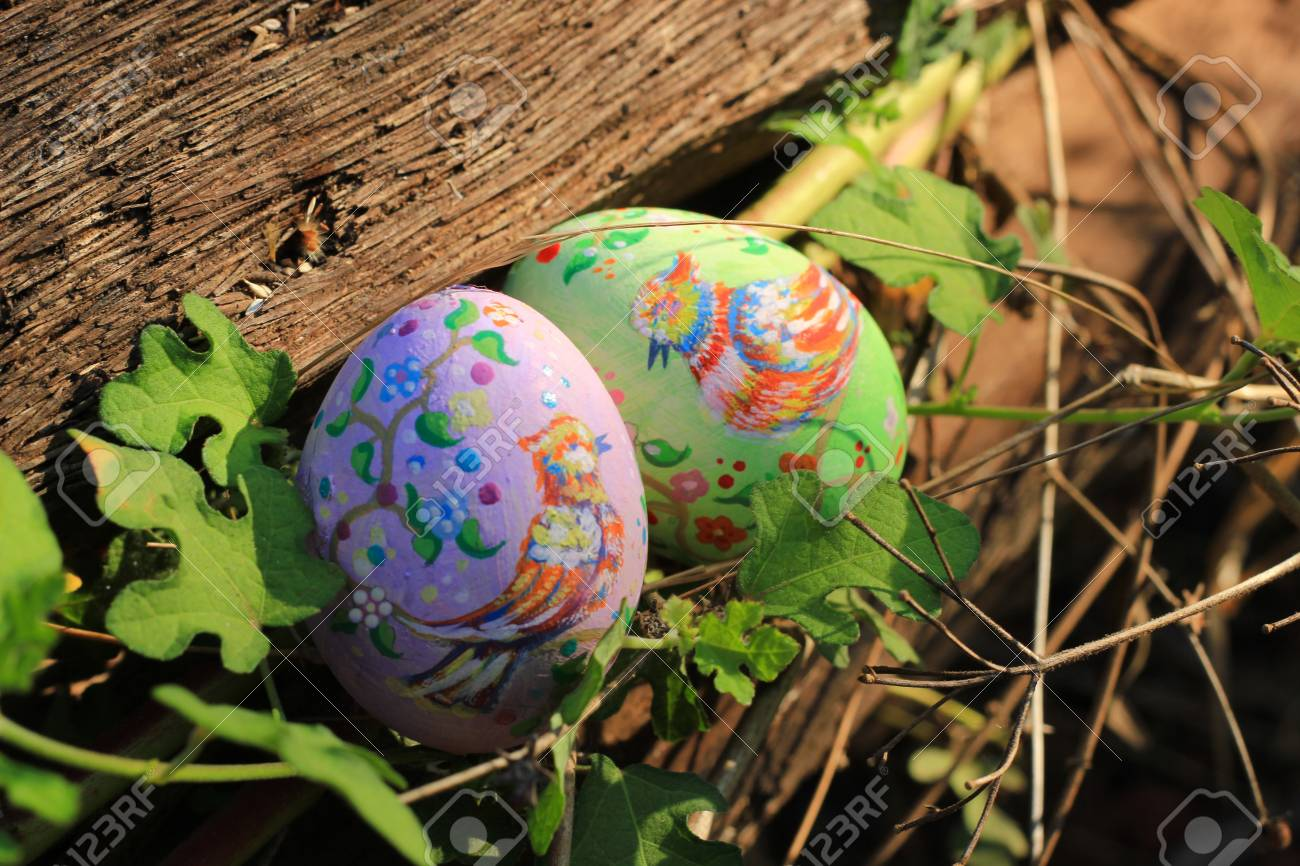 Painted Easter eggs hidden on the grass, ready for the easter..