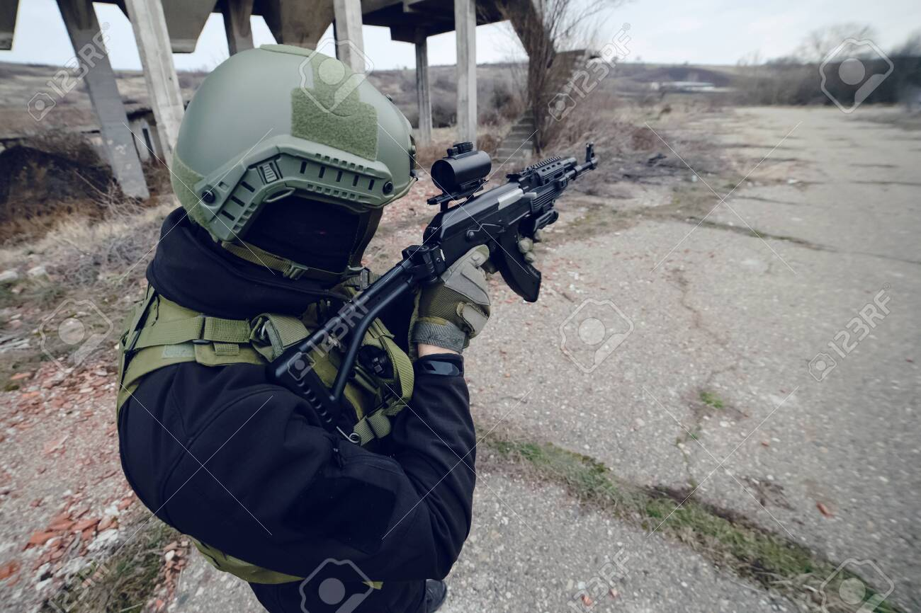 Special Forces Police Soldier Armed With Machine Gun Aiming Ready