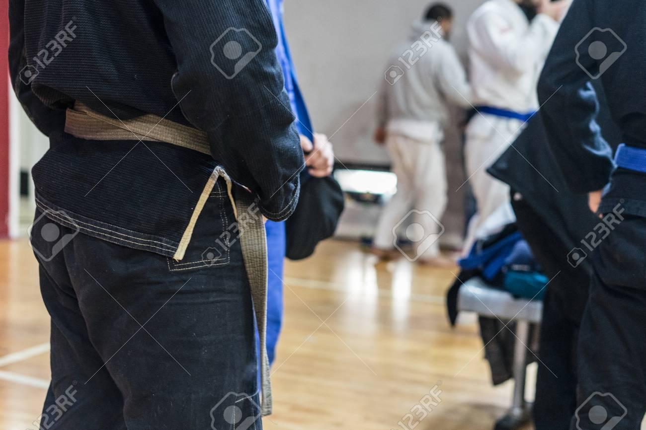 Close up on midsection of brazilian jiu jitsu BJJ fighter holding