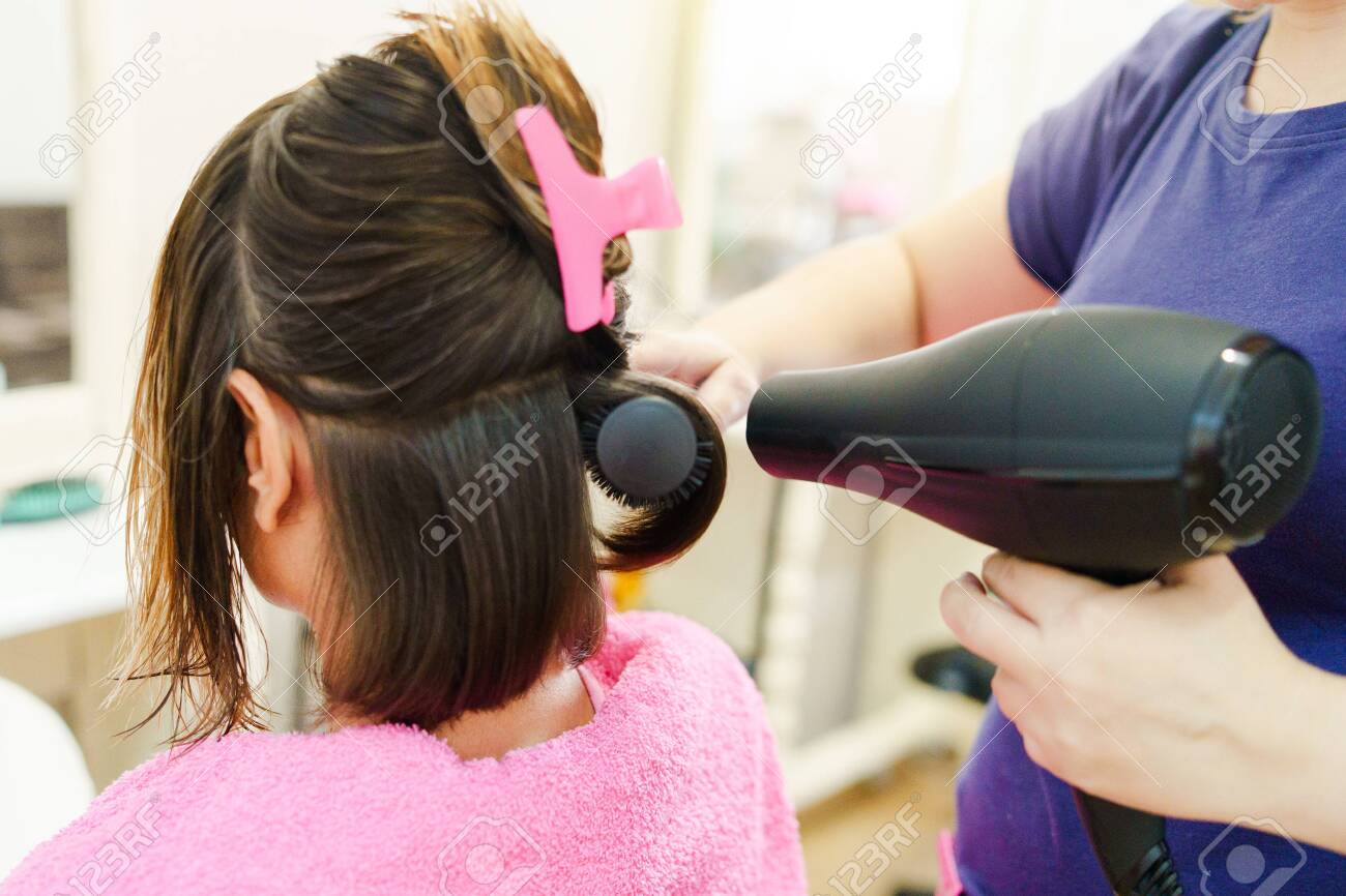 Professional Female Hairdresser Drying Woman S Hair Styling Using Stock Photo Picture And Royalty Free Image Image 128714318