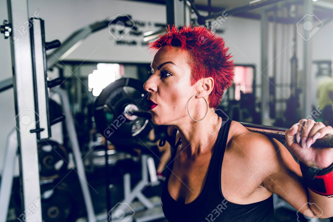 Close Up On Caucasian Woman Red Short Hair Training At The Gym Stock Photo Picture And Royalty Free Image Image 136841041