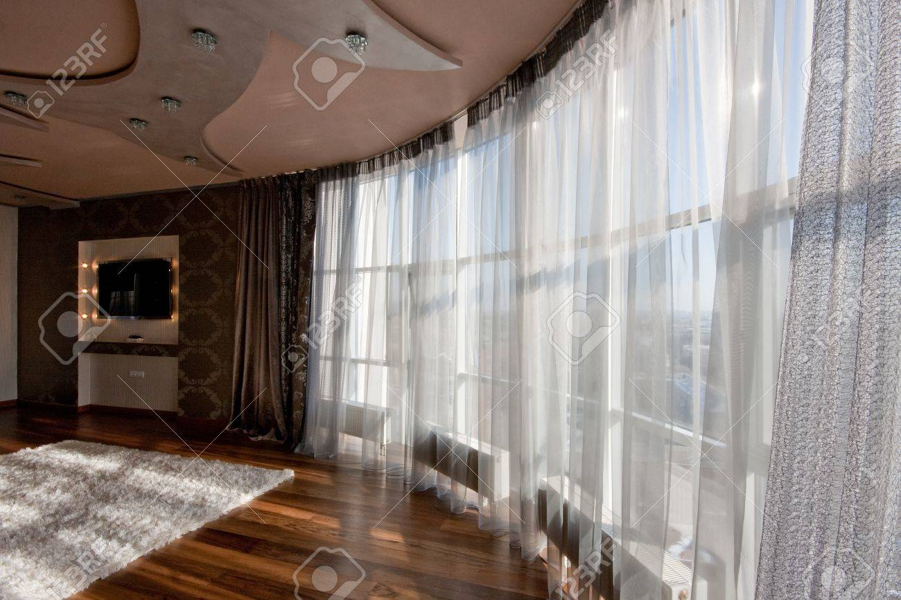 Wide Angle View Of Panoramic Window With Net Curtain In Modern Living Room  Stock Photo Part 33
