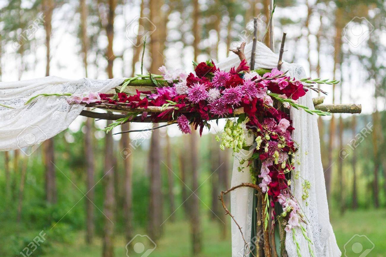 Detail of wedding decoration wooden arch corner with flowers detail of wedding decoration wooden arch corner with flowers in the wood stock photo junglespirit Gallery