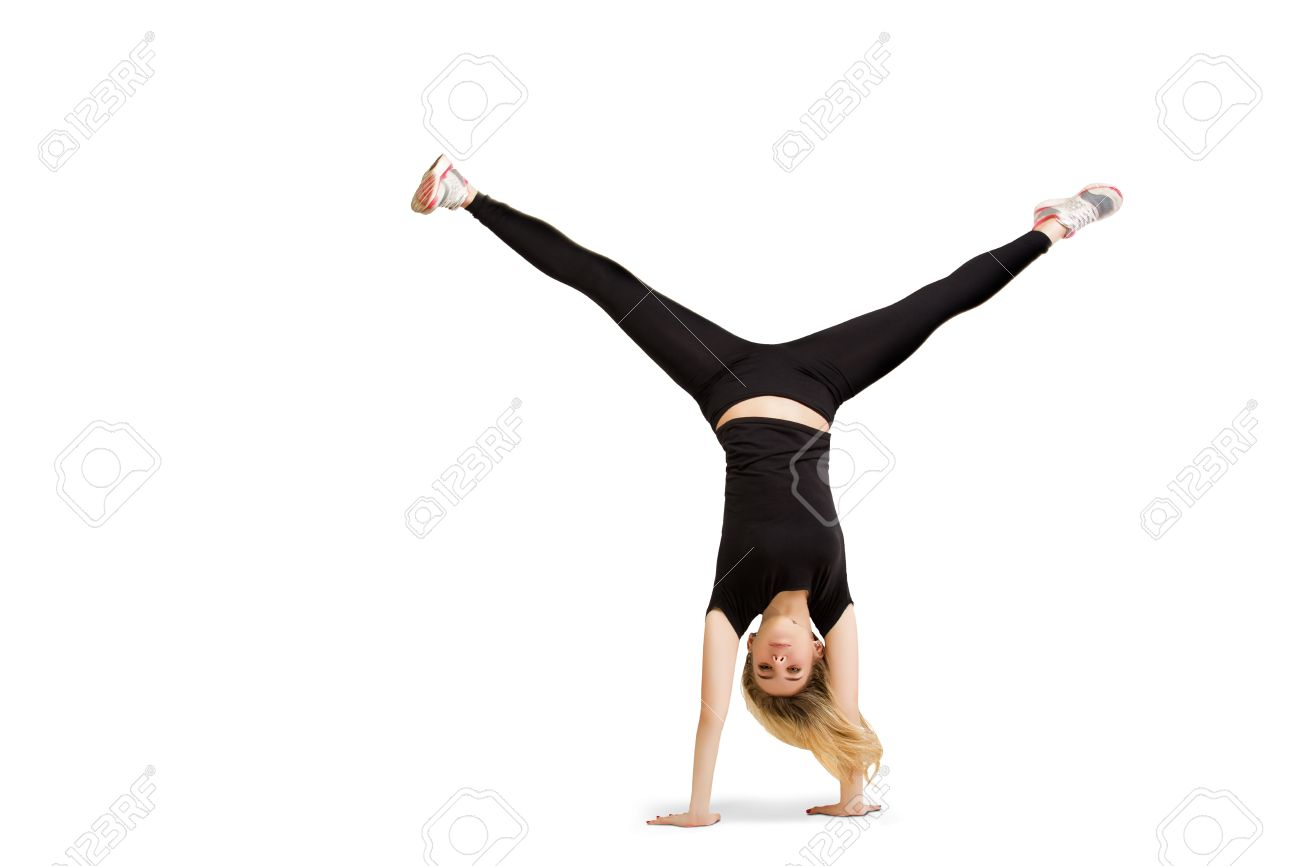 Caucasian Woman Does Cartwheel Gymnastics. Fitness Girl In ...