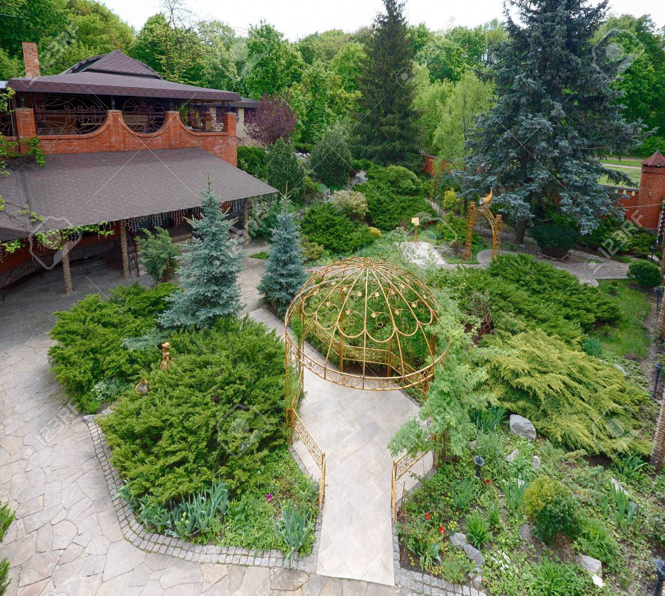 Beautiful Landscape Design, Garden Path With Stone Tiles, Evergreen Bushes,  Fir Trees,