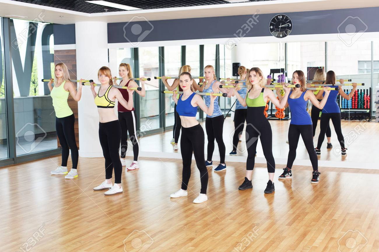 Group of young women in fitness class making exercises  Girls