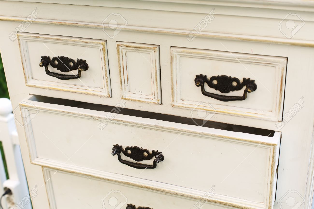 Old Wooden Antique Chest Of Drawers With Metal Handles Closeup