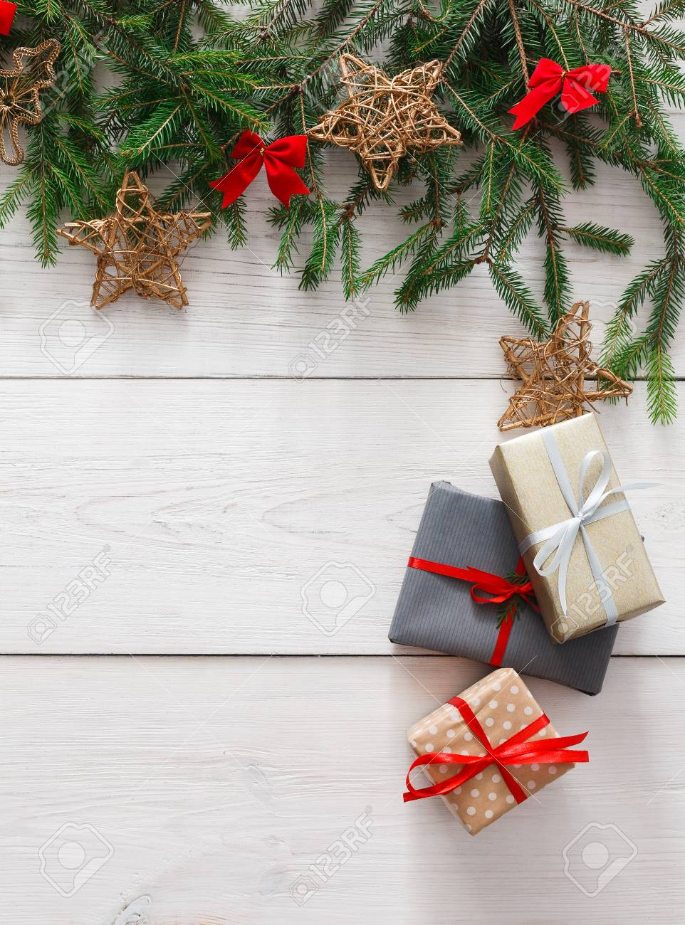 Christmas Decoration Gift Boxes And Garland Frame Concept Background Top View With Copy Space