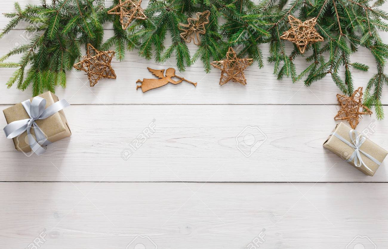 Christmas decoration, gift boxes, garland and angel figure frame..