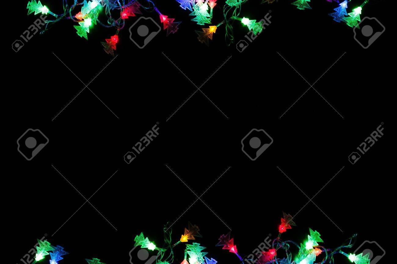 christmas lights frame on black background holiday shiny garland border top view xmas tree - Christmas Lights Frame