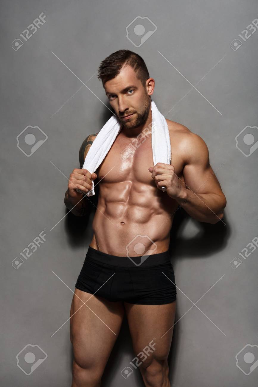Naked male exercising