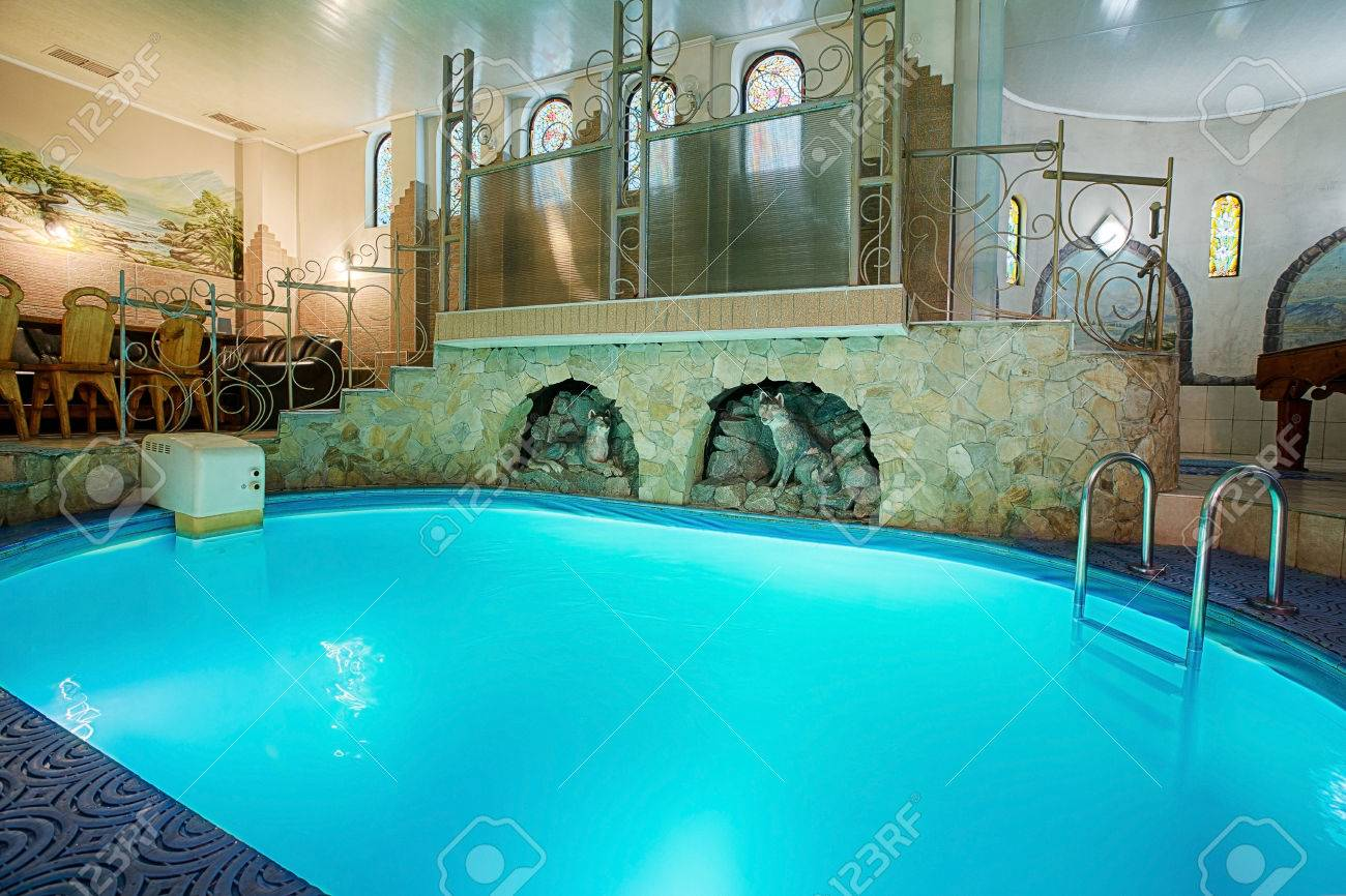 Blue swimming pool in modern spa interior resort and wellness